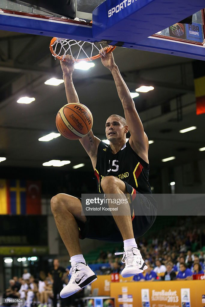 Maik Zirbes of Gemany hangs on the basket during the FIBA European Championships 2013 first round group A match between France and Germany at Tivoli Arena on September 4, 2013 in Ljubljana, Slovenia.