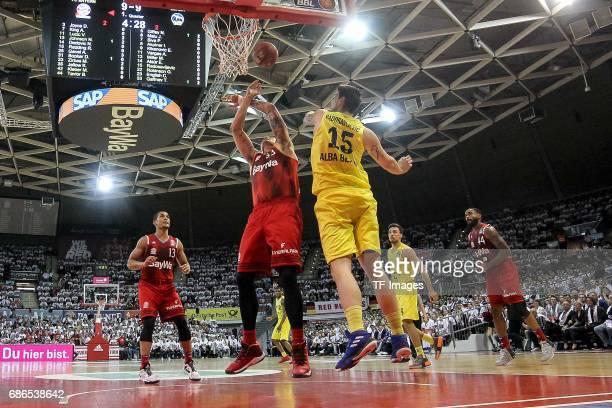 Maik Zirbes of Munich und Bogdan Radosavljevic of Berlin battle for the ball during the easyCredit BBL Basketball Bundesliga match between FC Bayern...