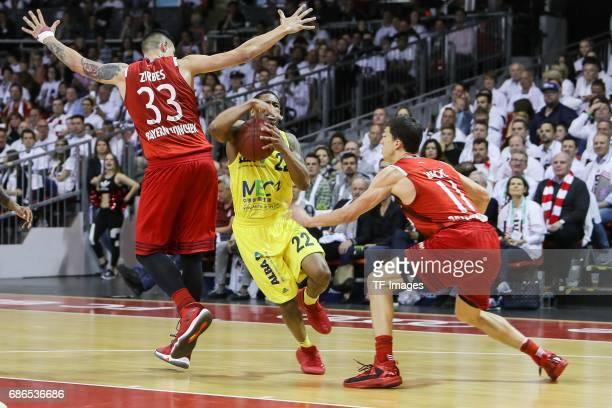 Maik Zirbes of Munich Vladimir Lucic of Munich und Gerald Robinson of Berlin battle for the ball during the easyCredit BBL Basketball Bundesliga...