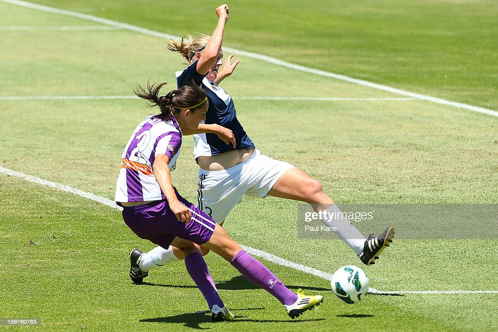 Maika Ruyter-Hooley of the Victory blocks a shot at goal by Kathryn Gill of the Glory during the W-League Semi Final match between Perth Glory and Melbourne Victory at nib Stadium on January 20, 2013 in Perth, Australia.