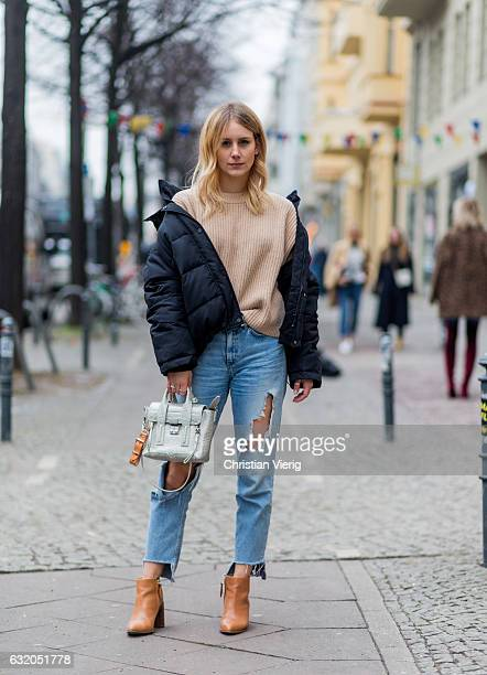 Maike Schmitzke wearing a down feather jacket beige knit Phillip Lim silver bag ripped denim jeans brown ankle boots during the MercedesBenz Fashion...