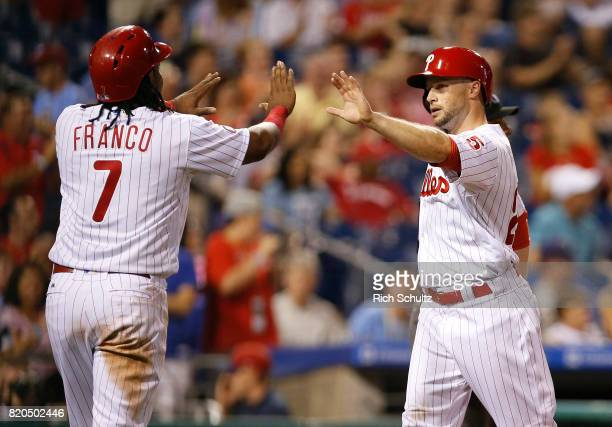 Maikel Franco and Daniel Nava of the Philadelphia Phillies congratulate each other after scoring on a double by Tommy Joseph during the sixth inning...