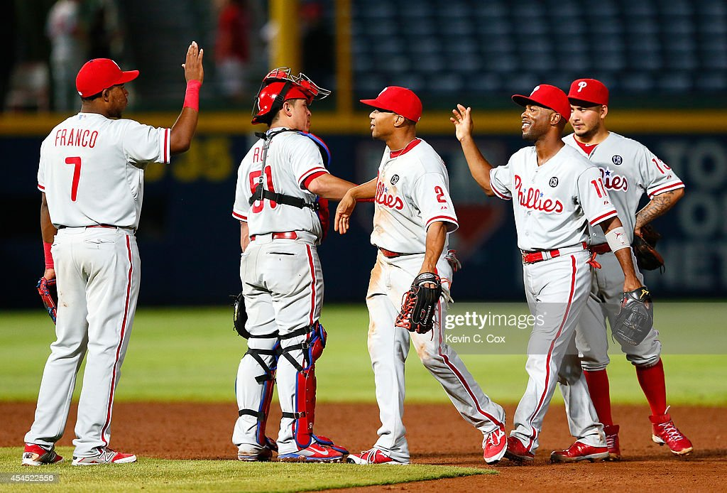 <a gi-track='captionPersonalityLinkClicked' href=/galleries/search?phrase=Maikel+Franco&family=editorial&specificpeople=11198645 ng-click='$event.stopPropagation()'>Maikel Franco</a> #7, Carlos Ruiz #51, <a gi-track='captionPersonalityLinkClicked' href=/galleries/search?phrase=Ben+Revere&family=editorial&specificpeople=6826641 ng-click='$event.stopPropagation()'>Ben Revere</a> #2, <a gi-track='captionPersonalityLinkClicked' href=/galleries/search?phrase=Jimmy+Rollins&family=editorial&specificpeople=204478 ng-click='$event.stopPropagation()'>Jimmy Rollins</a> #11 and <a gi-track='captionPersonalityLinkClicked' href=/galleries/search?phrase=Freddy+Galvis&family=editorial&specificpeople=6772271 ng-click='$event.stopPropagation()'>Freddy Galvis</a> #13 of the Philadelphia Phillies celebrate their 4-0 shutout win over the Atlanta Braves at Turner Field on September 2, 2014 in Atlanta, Georgia.