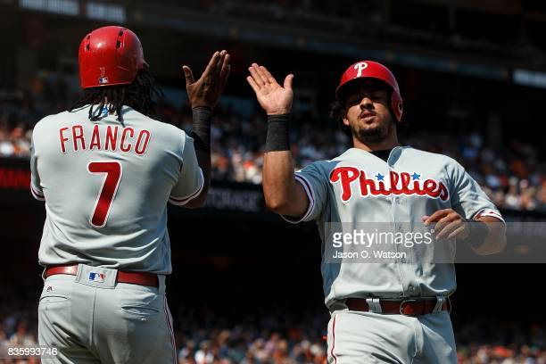 Maikel Franco of the Philadelphia Phillies and Jorge Alfaro celebrates after both scored on a single hit by Pedro Florimon during the eighth inning...