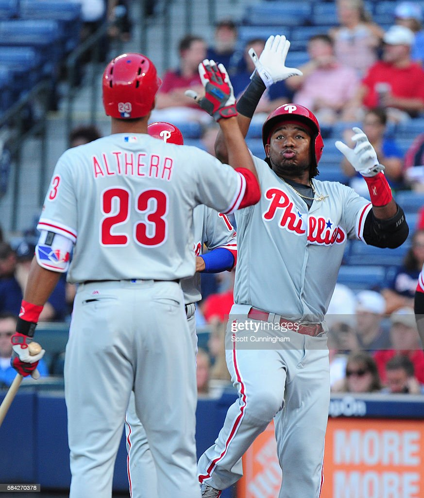 Maikel Franco #7 of the Philadelphia Phillies celebrates with Aaron Altherr #23 after hitting a first inning three-run home run against the Atlanta Braves at Turner Field on July 28, 2016 in Atlanta, Georgia.