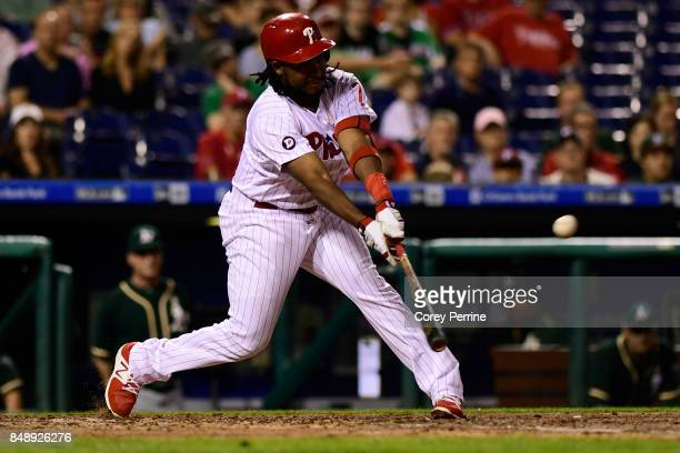 Maikel Franco of the Philadelphia Phillies flies out against the Oakland Athletics during the fourth inning at Citizens Bank Park on September 16...