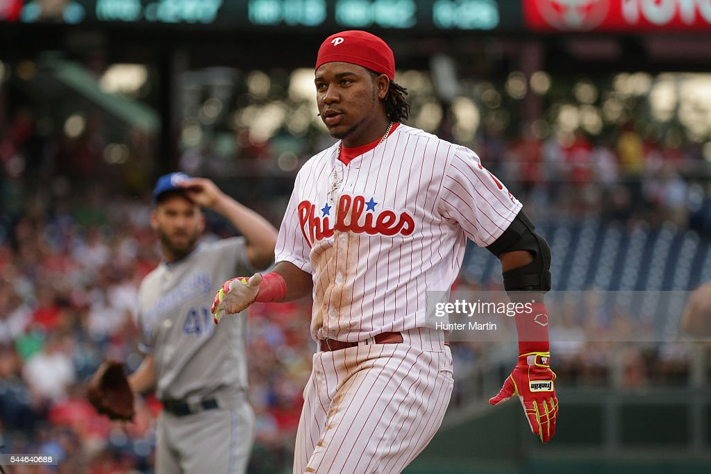 Maikel Franco #7 of the Philadelphia Phillies loses his helmet as he runs back to first base after an infield single in the first inning during a game against the Kansas City Royals at Citizens Bank Park on July 2, 2016 in Philadelphia, Pennsylvania. The Royals won 6-2.