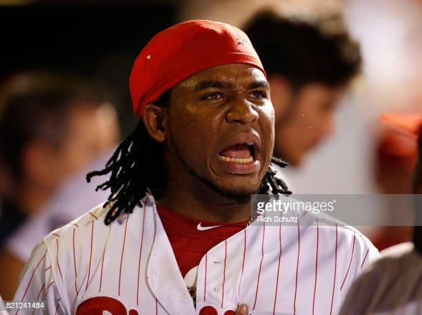 Maikel Franco of the Philadelphia Phillies reacts after scoring with Daniel Nava on a double by Tommy Joseph during the sixth inning of a game...