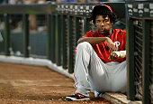 Maikel Franco of the Philadelphia Phillies watches from the dugout during the MLB game against the Arizona Diamondbacks at Chase Field on August 12...