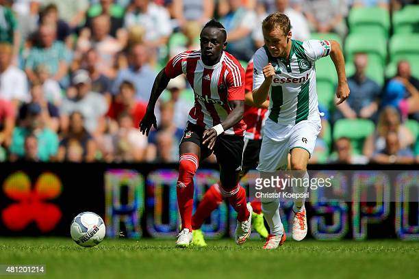 Maikel Kifetenbeld of Groningen challenges Sadio Mane of FC Southampton during the friendly match between FC Groningen and FC Southampton at Euroborg...