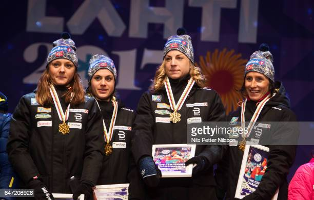 Maiken Caspersen Falla Heidi Weng Astrid Uhrenholdt Jacobsen and Marit Bjorgen of Norway during the medal ceremony after the women's cross country...