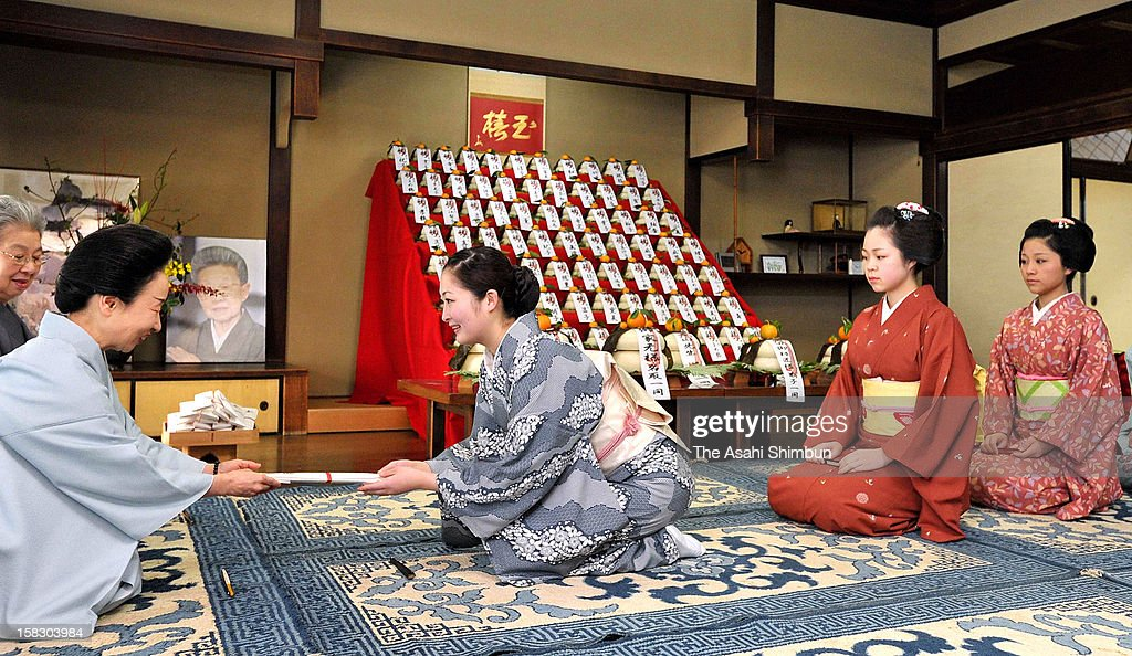 Maiko and geiko greet to their dance master to show their gratitude for the past year and best wishes for the new year and receives dance fans on December 13, 2012 in Kyoto, Japan. The annual ritual is called 'Kotohajime', and is the start of preparation for the new year.