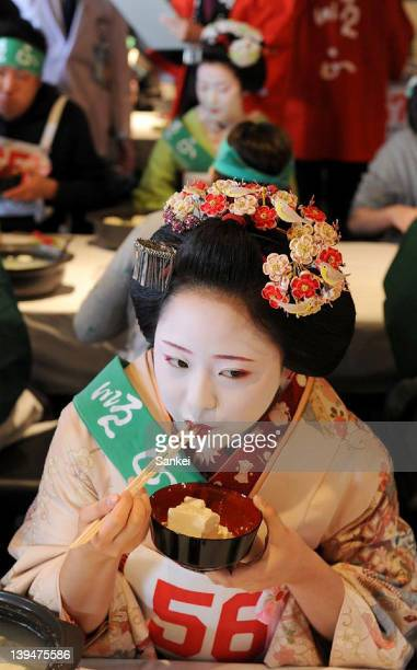A Maiko eats boiled bean curd during the 38th Boiled Bean Curd Eating Contest at Kiyomizu Junsei Okabeya on February 20 2011 in Kyoto Japan The...