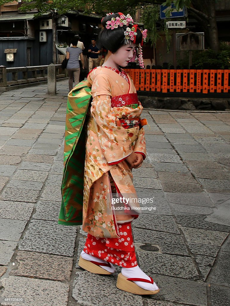 A Maiko girl walks at Gion Street on July 5, 2014 in Kyoto, Japan. Kyoto has been named the world's best city in the U.S. magazine Travel + Leisure for 2014, according to its website. The former capital of Japan is known for old temples and shrines.