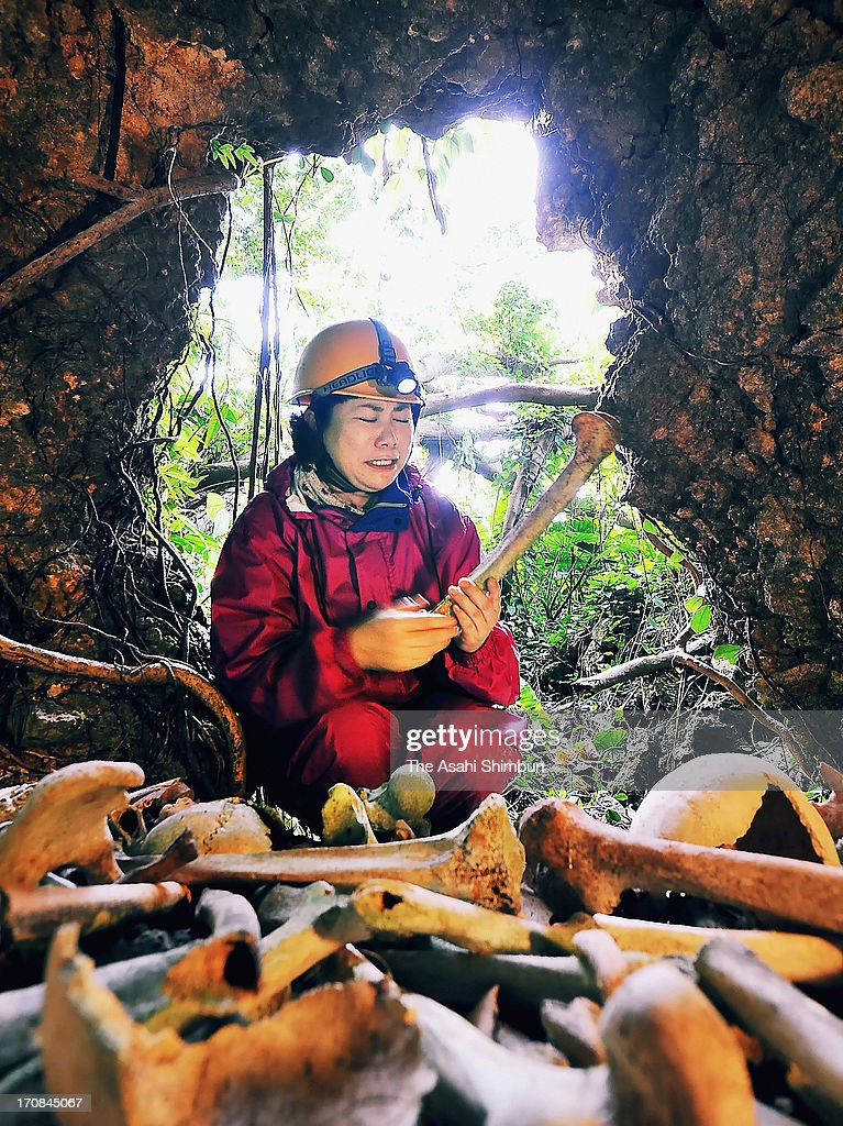 Maiko Masaki sheds tears as she found the remains of victims of the battle of Okinawa at a cave on February 5, 2013 in Itoman, Okinawa, Japan. During three-month long battle, one-fourth of Okinawan were killed at the end of World War II.