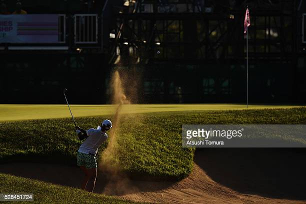 Maiko Wakabayashi of Japan hits from a bunker on the 18th hole during the first round of the World Ladies Championship Salonpas Cup at the Ibaraki...