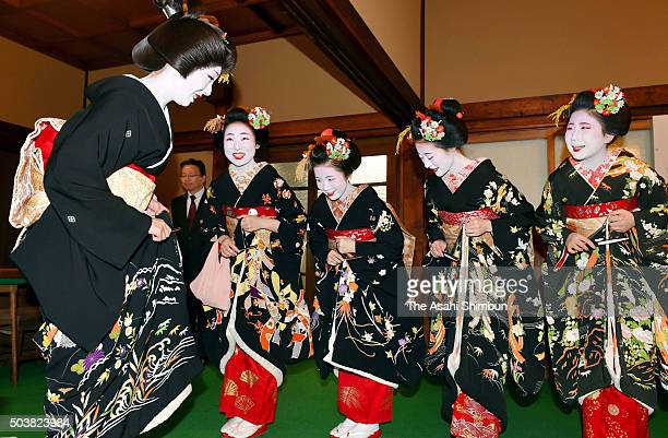 Maikos and geikos greet each other at the new year's ceremony to mark the start of business at the Gion Kobu Kaburenjo Theater on January 7 2016 in...