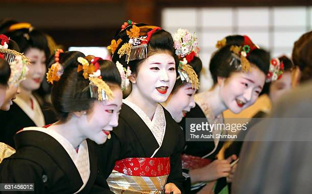 Maikos and geikos greet each other at the new year's ceremony to mark the start of business at the Gion Kobu Kaburenjo Theater on January 7 2017 in...