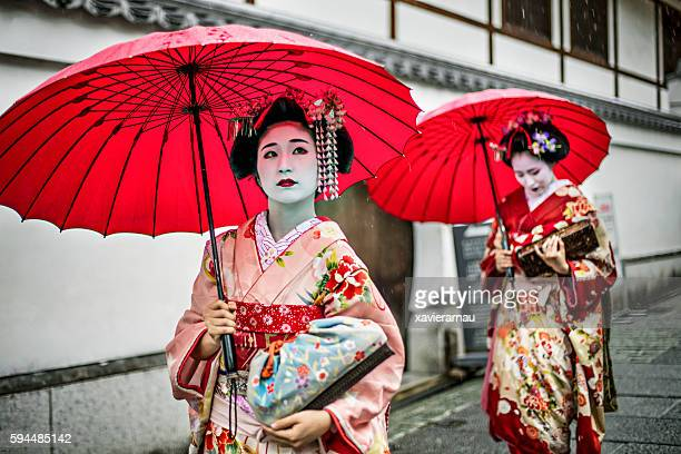 Maikos walking in the streets of Kyoto