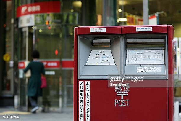 A mail box stands outside a Japan Post Co post office in Tokyo Japan on Monday Oct 26 2015 Japan Post Holdings and its banking unit rallied above...