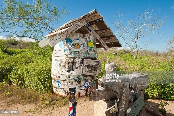 Mail drop barrel at Post Office Bay Isla Santa Maria or Floreana Island Galapagos Islands Ecuador