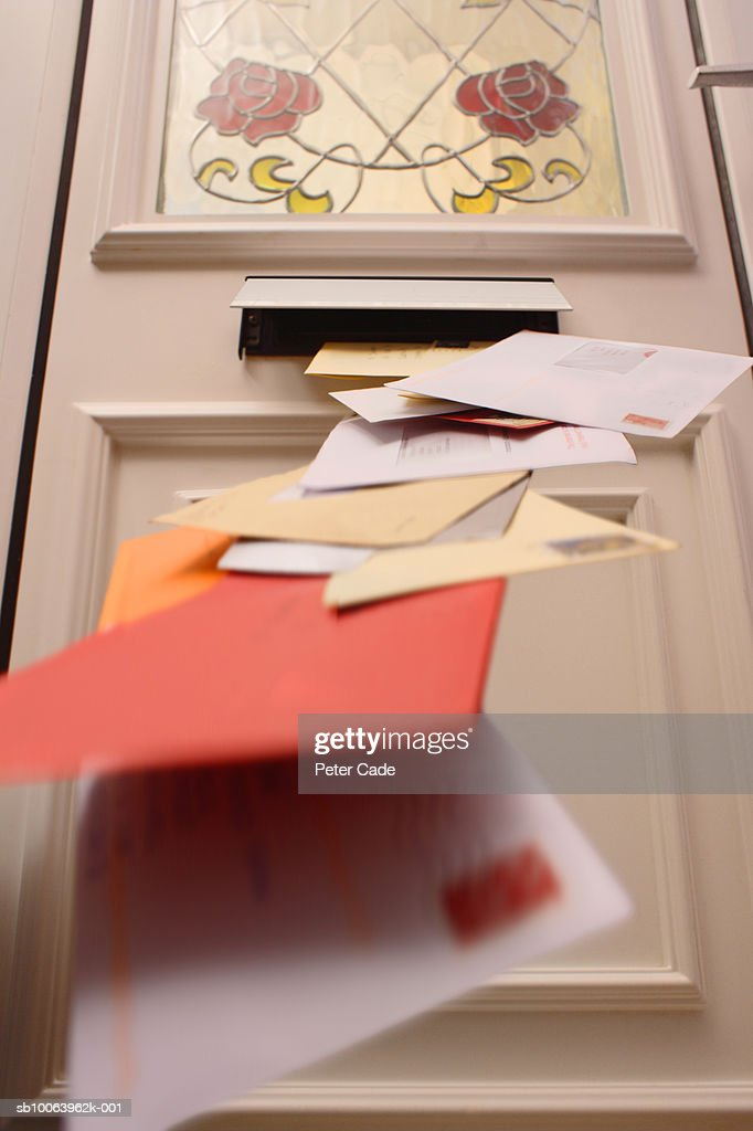 Mail falling from letterbox, low angle view : Stock Photo