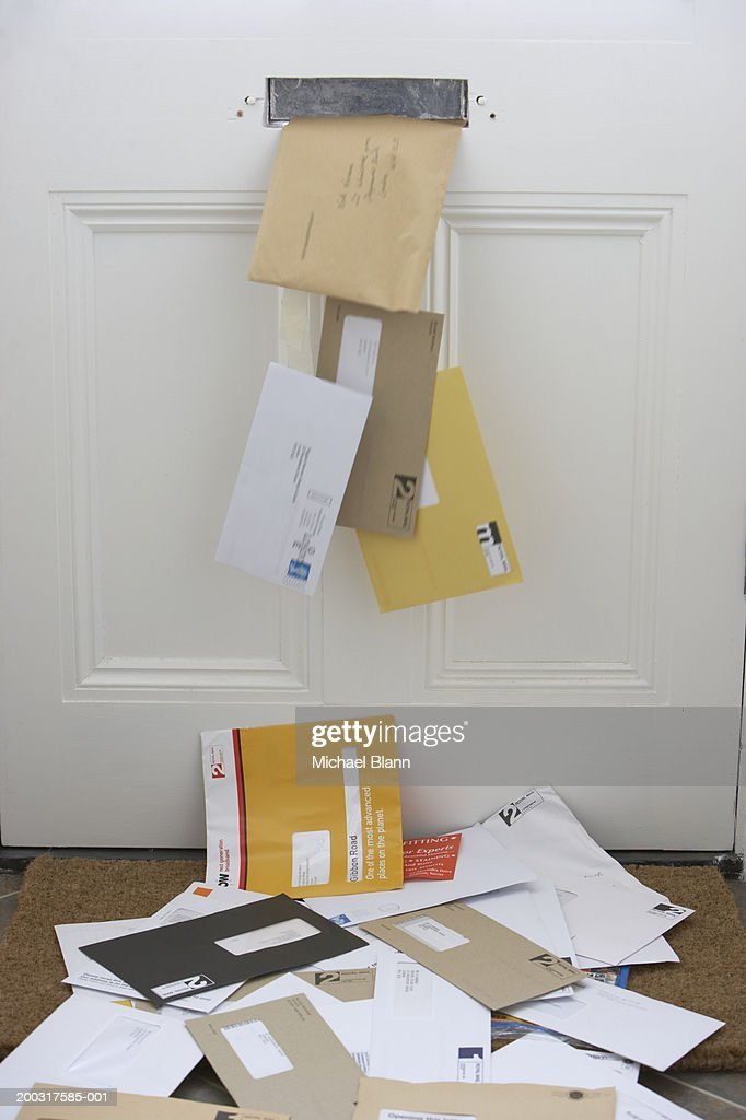 Mail falling from letterbox onto doormat (Digitally Enhanced) : Stock Photo