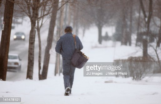 mail man in snow storm : Stock Photo