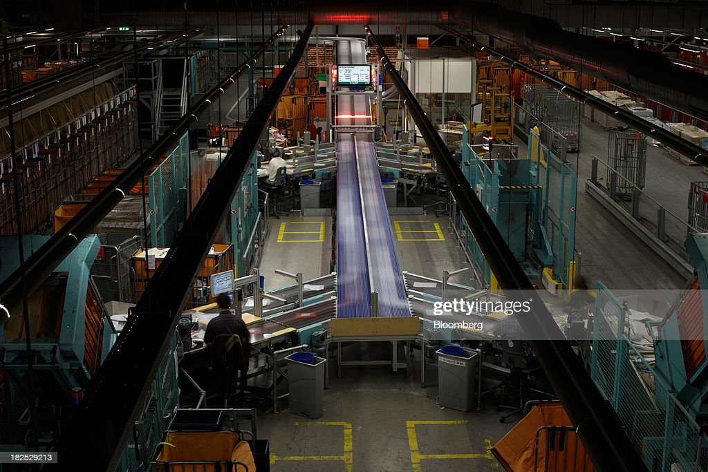 Mail moves along conveyor belts at the PostNL NV sorting center in Nieuwegein, Netherlands, on Friday, Sept. 27, 2013. PostNL NV rose the most in two months on Sept. 19 after the Dutch postal operator raised its full-year forecast and announced higher prices for stamps. Photographer: Jasper Juinen/Bloomberg via Getty Images