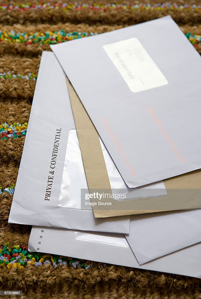 Mail on a doormat : Stock Photo