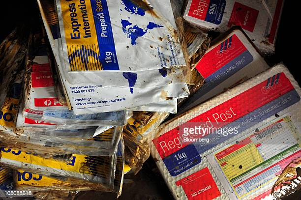 Mail packages are soiled after flooding inside a post office at the Brisbane Market in Rocklea a suburb of Brisbane Australia on Saturday Jan 15 2011...