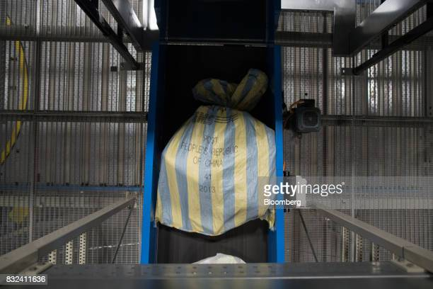A mail sack marked 'Post People's Republic Of China' passes along a conveyor belt inside the KLM Cargo center operated by Air FranceKLM Group at...