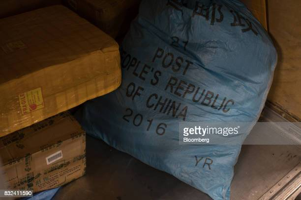 A mail sack marked 'Post People's Republic Of China' sits inside the KLM Cargo center operated by Air FranceKLM Group at Schiphol airport in...