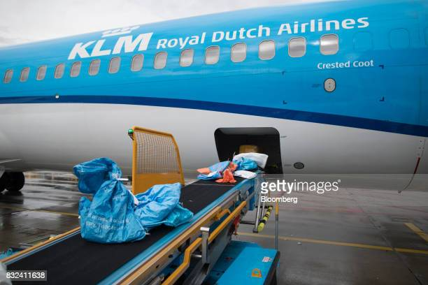 Mail sacks and packages pass along a conveyor as they are loaded onto an aircraft operated by KLM the Dutch arm of Air FranceKLM Group on the tarmac...
