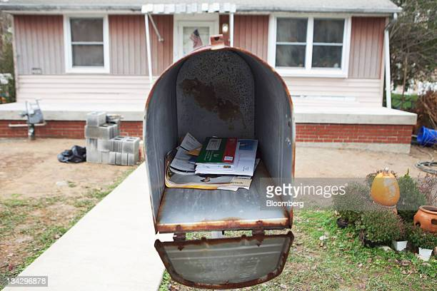 Mail sits in a mailbox after being delivered by US Postal Service city letter carrier Roy Sipe in Fairfax Virginia US on Wednesday Nov 30 2011 The...