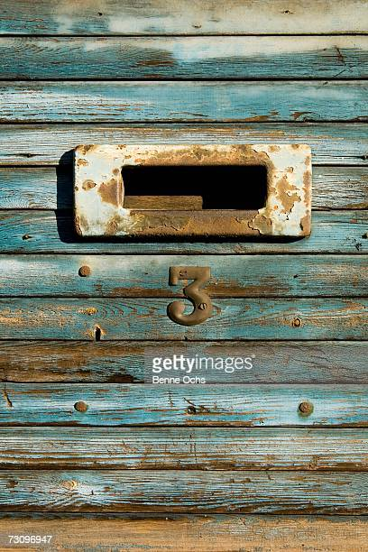 Mail slot on wooden panel