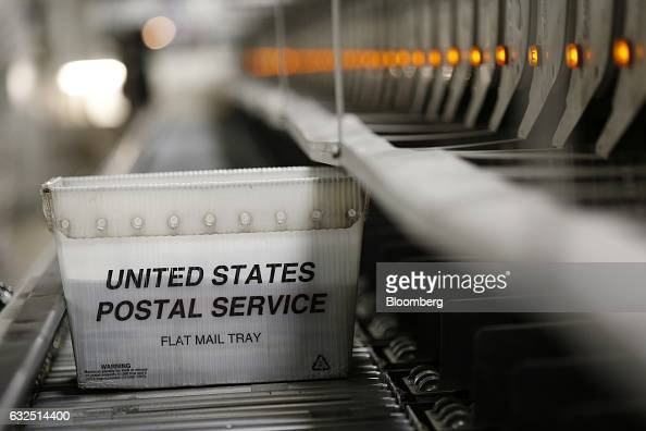 A mail tray moves along an automated sorting machine inside a United States Postal Service sorting center in Louisville Kentucky US on Friday Jan 13...