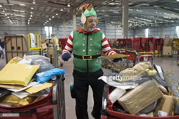 A mail worker dressed as an elf processes mail at the Royal Mail sorting office on December 16 2016 in Llantrisant Wales Hundreds of temporary...