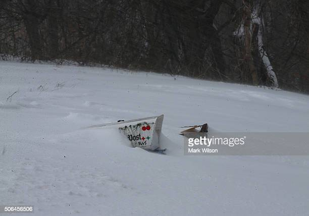 A mailbox and a Washington Post newspaper box are almost covered in a snow drift on Chaneyville Road January 23 2016 in Owings Maryland Heavy snow...