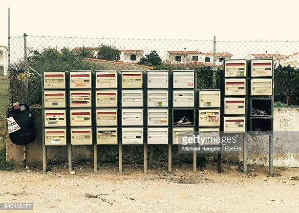 Mailboxes Against Chainlink Fence