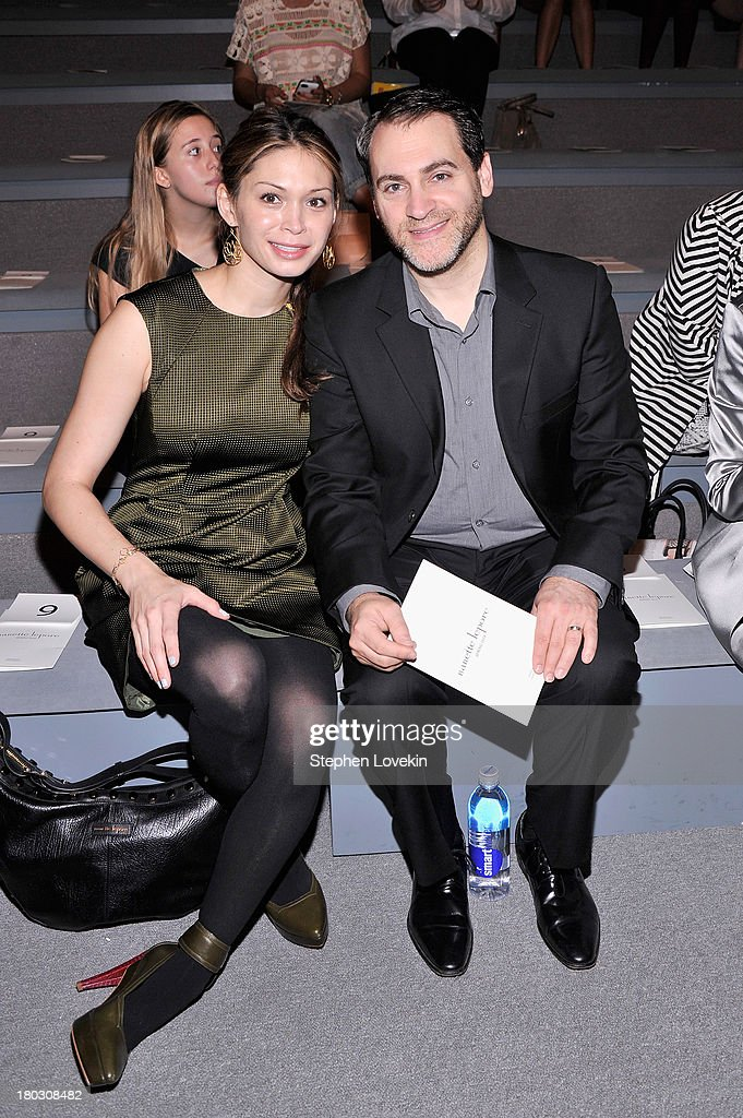 Mai-Linh Lofgren (L) and actor <a gi-track='captionPersonalityLinkClicked' href=/galleries/search?phrase=Michael+Stuhlbarg&family=editorial&specificpeople=228317 ng-click='$event.stopPropagation()'>Michael Stuhlbarg</a> attend the Nanette Lepore fashion show during Mercedes-Benz Fashion Week Spring 2014 at The Stage at Lincoln Center on September 11, 2013 in New York City.