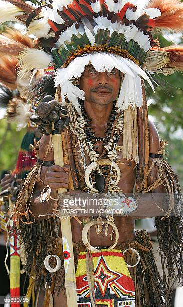 Mailovera warrior crowned with birdofparadise plumes and wearing wild boar tusks arrives for the independence day celebrations in Port Moresby 13...