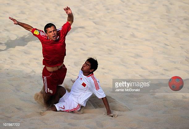 Maimaiti Tuluxun of China tackles Eyad Al Shehabi of Syria in the Men's Beach Soccer Quarterfinal between China and Syria at AlMusannah Sports City...