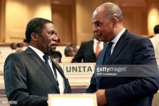 Main Angolan opposition party National Union for the Total Independence of Angola leader Isaias Samakuva talks with UNITA spokesperson Adalberto...