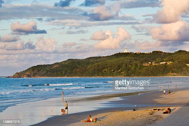 Main Beach with Cape Byron Lighthouse in background .