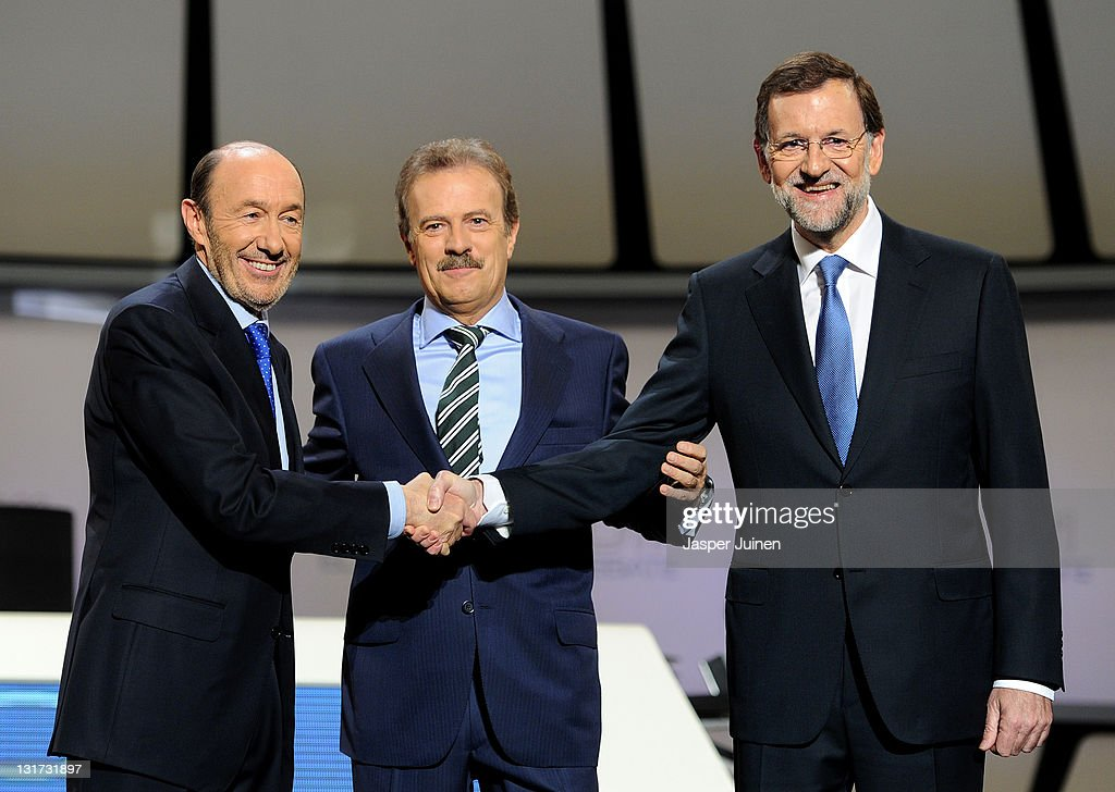 Main candidates for the Spanish general elections, Mariano Rajoy (R) of the Popular Party (PP) and <a gi-track='captionPersonalityLinkClicked' href=/galleries/search?phrase=Alfredo+Perez+Rubalcaba&family=editorial&specificpeople=692536 ng-click='$event.stopPropagation()'>Alfredo Perez Rubalcaba</a> of the Socialist Party (PSOE), smile as the great each other prior to the start of a live televised debate 'El Debate 2011' at the Palacio Municipal de Congresos de Madrid on November 7, 2011 in Madrid, Spain. Spaniards will flock to the polls on November 20, 2011, to vote on Spain's new Prime Minister and on the 208 directly elected seats in the upper house, the Senate.