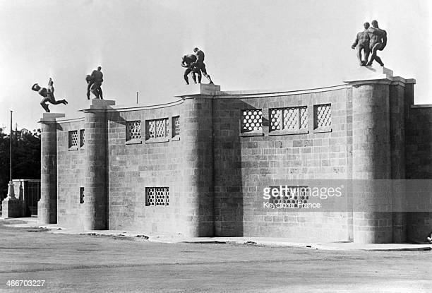 Main entrance of the new fascist stadium with statues symbolizing all sports in September 1929 in Rome Italy