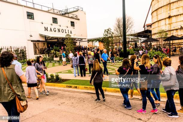 WACO, TX, USA  MARCH 18, 2017: Main entrance to Magnolia Market & Garden with female patrons taking photos with cell phone.