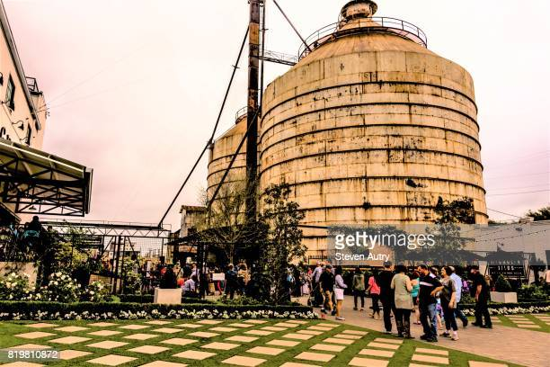 WACO, TX, USA  MARCH 18, 2017: Main entrance to Magnolia Silos with numerous patrons entering and the silos in the background.