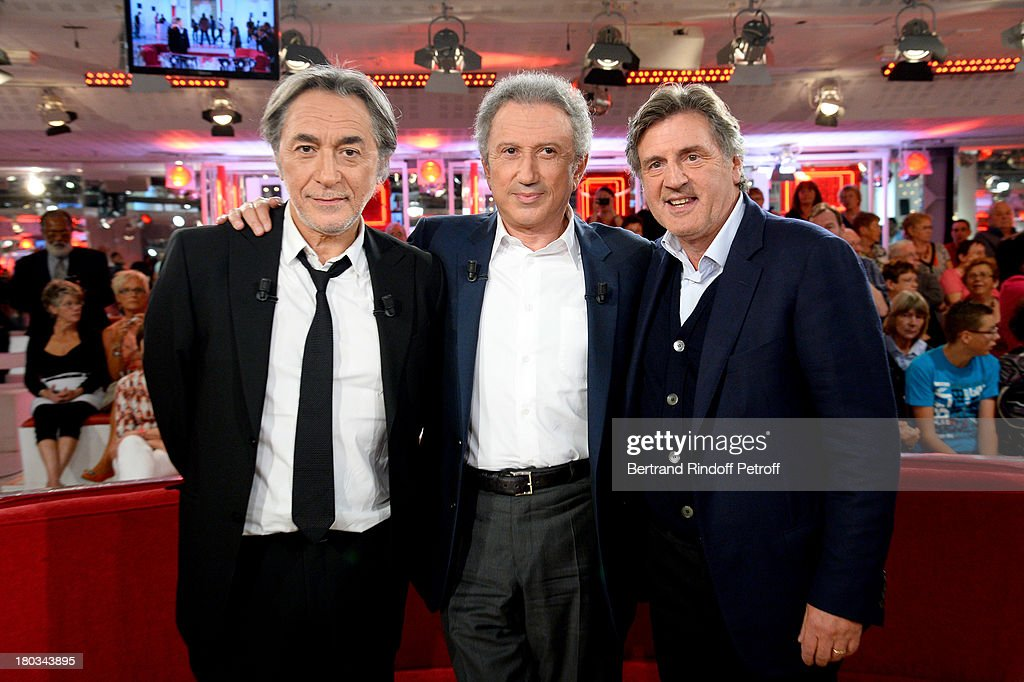 Main Guest actor Richard Berry, TV presenter <a gi-track='captionPersonalityLinkClicked' href=/galleries/search?phrase=Michel+Drucker&family=editorial&specificpeople=769504 ng-click='$event.stopPropagation()'>Michel Drucker</a> and actor <a gi-track='captionPersonalityLinkClicked' href=/galleries/search?phrase=Daniel+Auteuil&family=editorial&specificpeople=239190 ng-click='$event.stopPropagation()'>Daniel Auteuil</a> attend 'Vivement Dimanche' French TV Show at Pavillon Gabriel on September 11, 2013 in Paris, France.